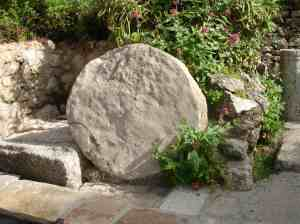 "typical stone that would have been ""rolled"" over Christ's tomb"
